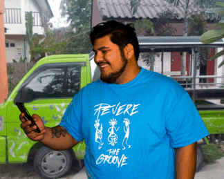 man with blue t shirt with revere the groove band figures